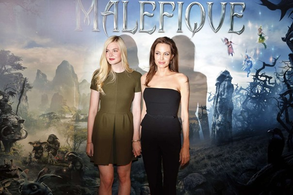 Elle-Fanning-and-Angelina-Jolie-at-Maleficent-photocall-in-Paris-11